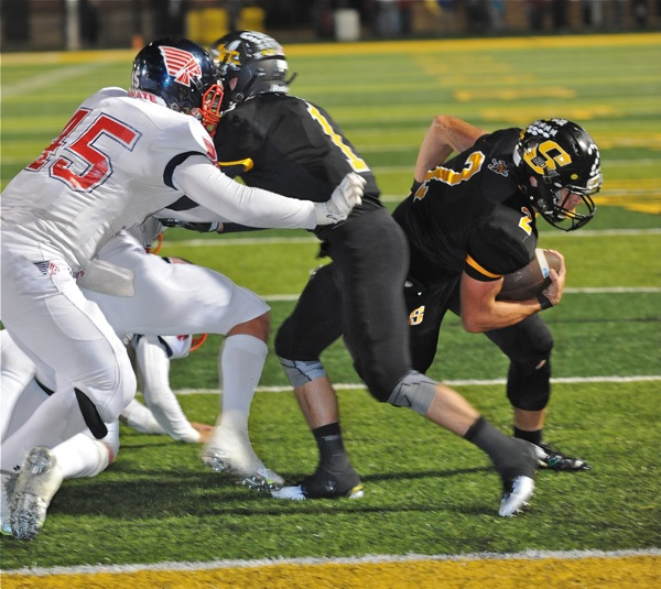 Bowser sneaks behind the block of teammate Connor Beer to score his 18th touchdown of the season in Thursday's loss to Piqua.