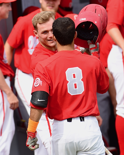 Noah West is congratulated on his first collegiate homer, coming in third inning of the first game.