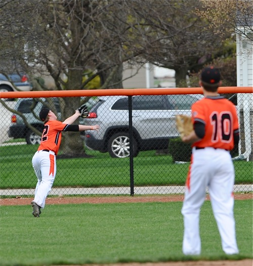 Coldwater second baseman Jacob Wenning watches teammate Doug Giere run down a shot to right field by Bryce Schmiesing in the second inning.
