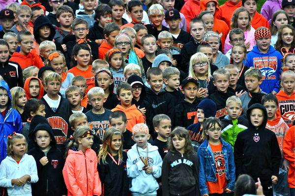 Elementary school children from Coldwater sang the National Anthem prior to Friday's game in remembrance of the anniversary of the 911 attack and its victims.