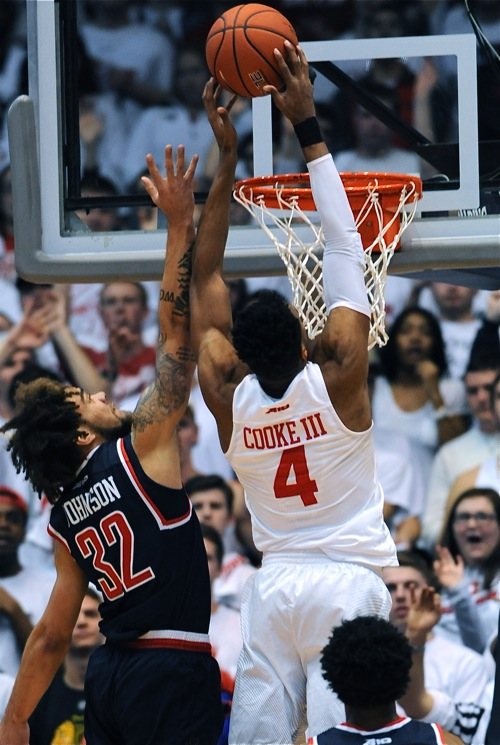 Charles Cooke played above the rim to score over Richmond's Julius Johnson.