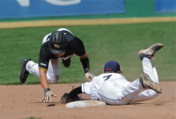 Brantley Johnson alertly tags a VCU runner out after oversliding second base.