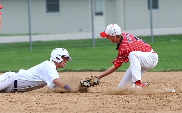 Fort Recovery's Ben Homan gets caught off second in the sixth inning of Thursday's win.
