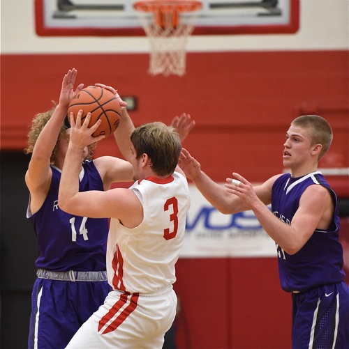 St. Henry's Mitch Schwieterman get's stymied by a Recovery double team during Tuesday's second half.