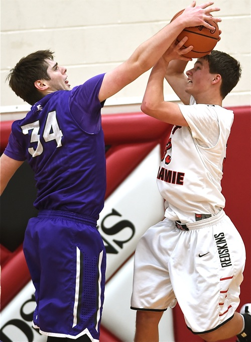 Recovery's Macaiah Cox (#34) only scored three points, but had a defensive moment of his own against Loramie's Eli Rosengarten.