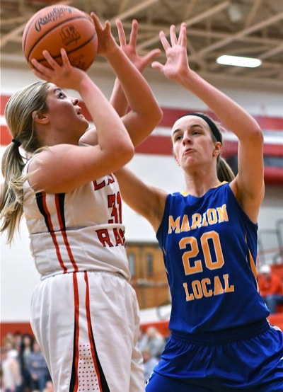 Marion's Kara Evers (#20, above) got the Flyers out to comfortable lead with 11 first half points, but spent much of the second half on the bench with foul trouble.