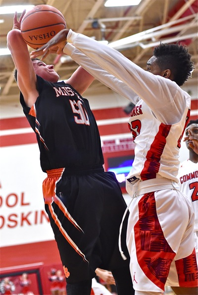 Minster's Jarod Schulze has his shot attempt stripped and discared by Lima Perry's LaMonte Nichols.