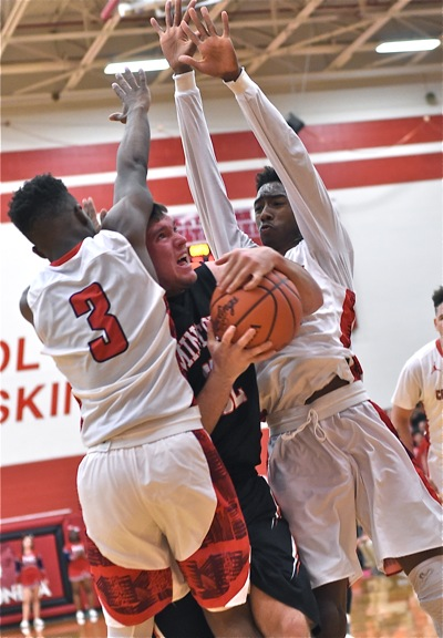 Minster's Isaac Dorsten feels the Perry pressure from Plummie Gardner (#3) and Nichols.