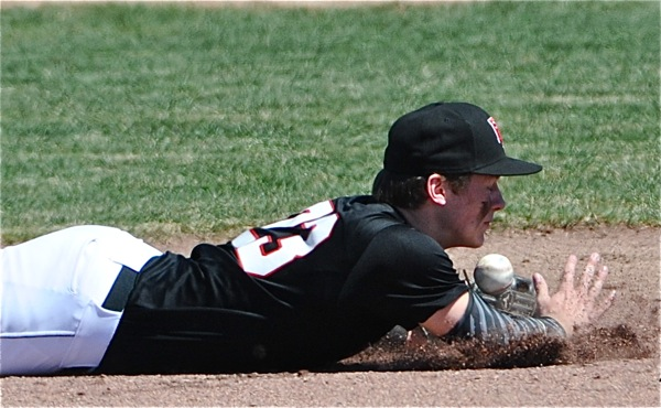 Loramie Devin Wehrman came this close to a diving stop on a Minster base hit in the fifth inning.
