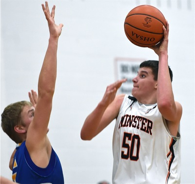 Minster's Jarod Schulze (#50) got the 'Cats off to a quick start, scoring the game's first six points.