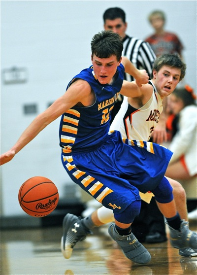 Marion's Collin Everman strips the ball away for a second quarter steal.