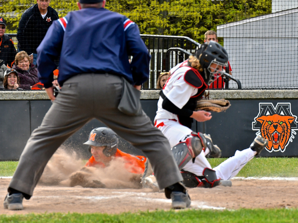 Safe at home plate gives Minster one for the score.