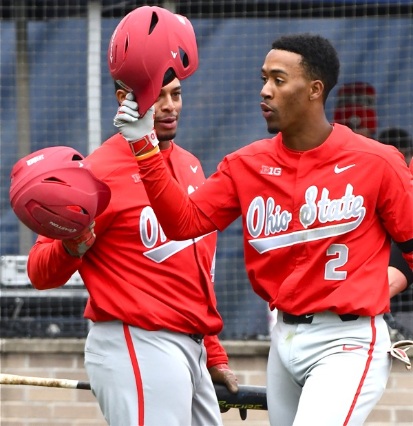 Captain Jalen Washington (#2) celebrates his second home run in the first game with Noah McGowan, who hit three in the second game.
