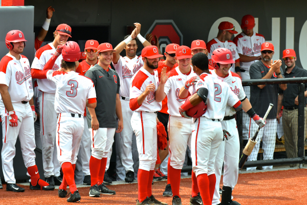 Celebration from the dugout for Senior Jalen Washington's final homerun at Bill Davis Stadium.