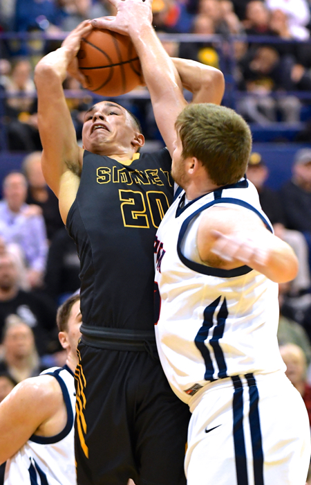 Nate Monnin makes it tough for Andre Gordan to get it to the hoop.