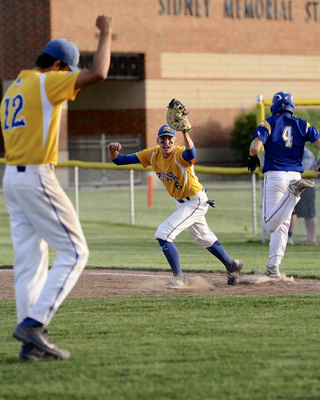 Russia pitcher Jack Dapore raises his fist in celebration as first baseman Hunter Lohee squeezes the final out in the Division IV sectional final win.