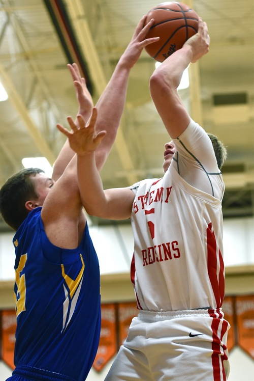 Goshen played tough in the early going, contesting the shot attempt of the Redskins' Tyler Schlarman.
