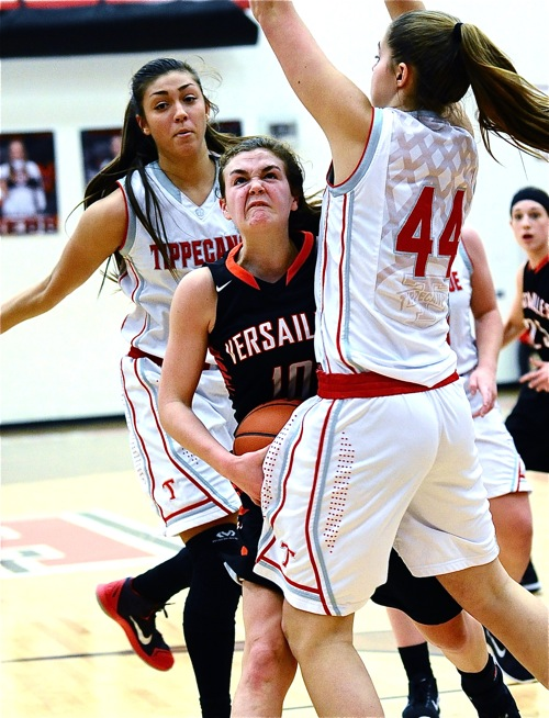 Tipp, the top defensive team in the GWOC North, put the squeeze on Versailles guard Kami McEldowney.