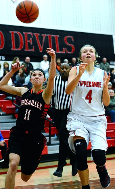 Tigers' guard Camille Watren slaps the ball away from Taylor Prall, denying another open look at the basket.