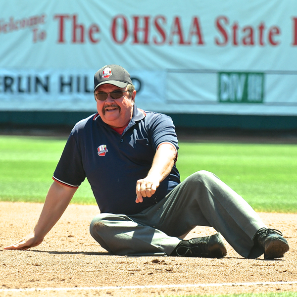 How they're callin' em at the tournament.  Umpire Rick Merb made the out call at first base in leisurely fashion...after falling down.