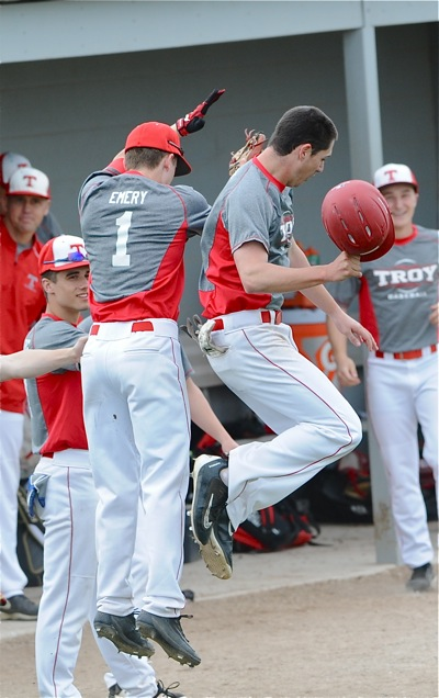 Brandon Emery and Jake Daniel celebrate the Trojans two first inning runs.