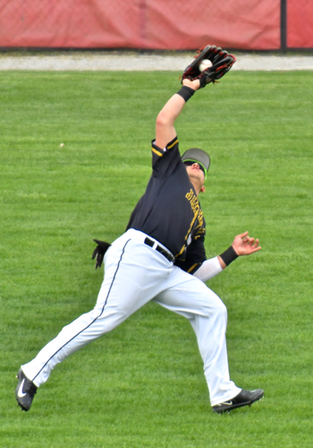 Sidney's Right fielder Ryan Heins makes a diving catch.