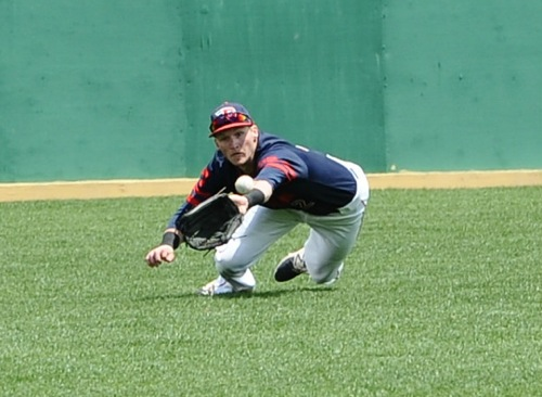 There is no quit...centerfielder Robbie Doring leaves his feet to make a diving catch attempt against VCU.