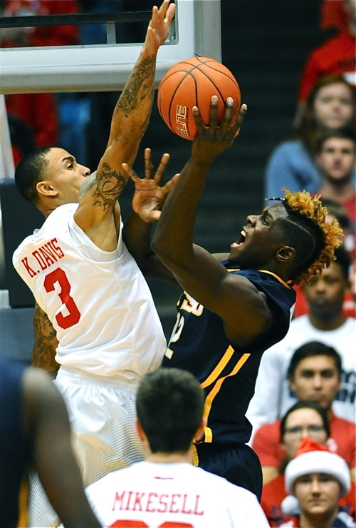 Kyle Davis got his licks in defensively, here blocking ETSU center Hanner Mosquere-Perea.