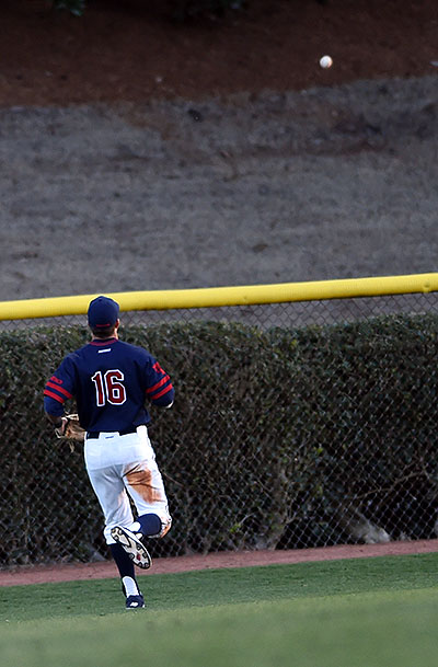 Left fielder Mitch Coughlin watches the eighth inning home run by Furman first baseman Brandon Elmy.