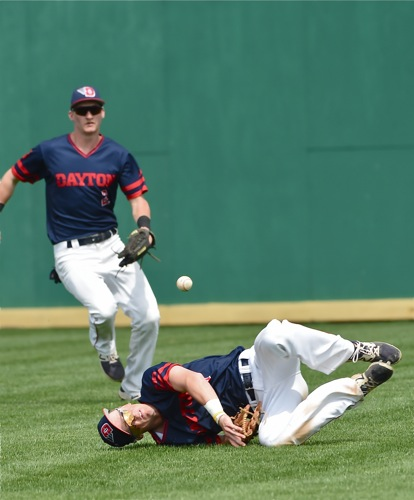 Right fielder Tate Hagen gets piled up attempting a diving catch in the sixth inning.