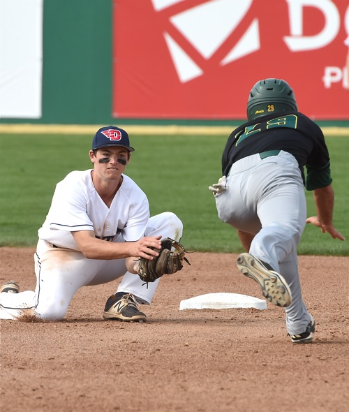 Flyer shortstop Brantley Johnson waits with the ball for Mason's Alejandro Aponte, trying to advance on a passed ball.