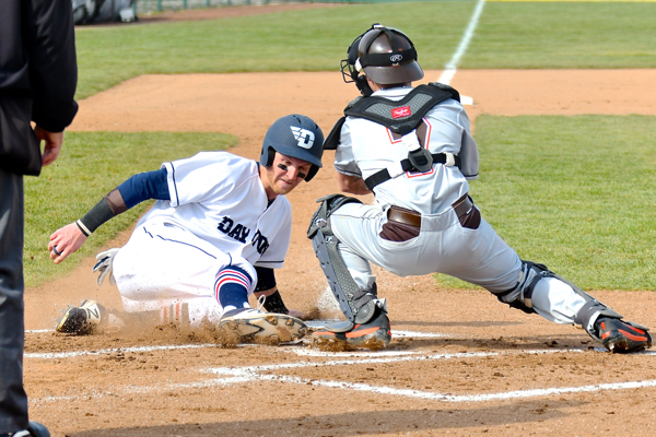 UD's Robbie Doring (safe at the plate)