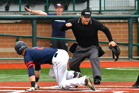 Robbie Doring was called out at the plate;  the guy in the background thought differently.