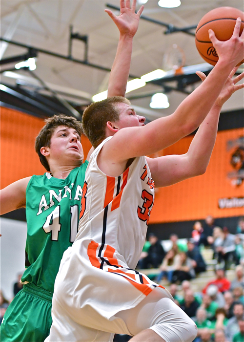AJ Ahrens drives past Anna's Seth Roe for a bucket.