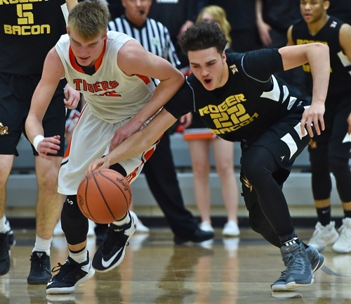 Roger Bacon's Justin Johnson pilfers the ball from Justin Ahrens in Wednesday's regional loss.