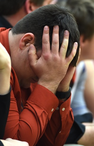 Painful...assistant coach Josh Langston hides his frustration as the clock ran out on the Tigers' season.