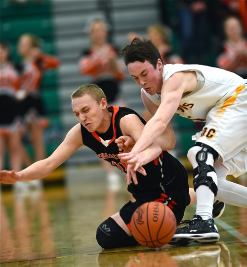 Alex Wendel battles DC's Matt Welker for a loose ball in the first half.