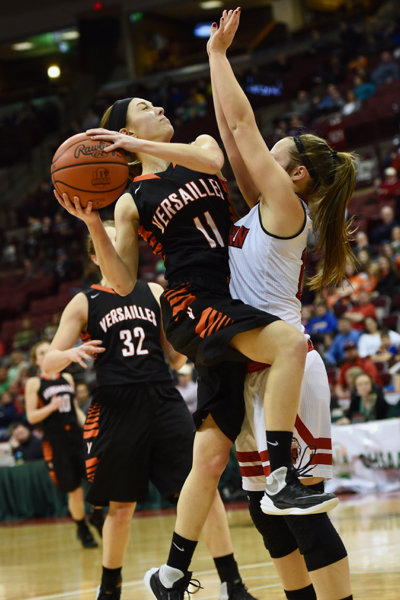 Camille Watren got it started with a trio of three-pointers, and was fearless to challenge Eastern Brown's Mikayla Farris.