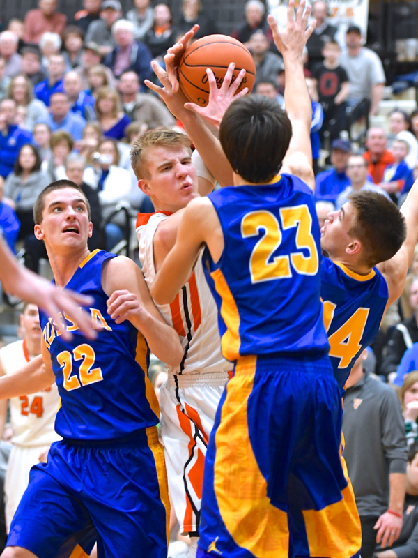 Justin Ahrens was surrounded by Raider's defense most of the night.