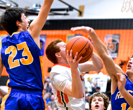 Keaton McEldowney scores 12 for the Tigers and had to work at it with the Raider's defenders on him all night.