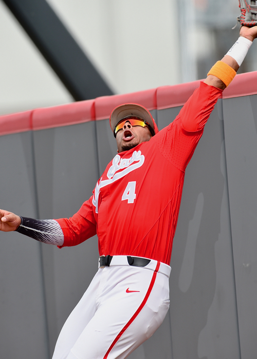The Buckeyes Noah McGowan stretches but could not reach the home run by the Gophers' Jordan Smith in the 5th inning of game one.