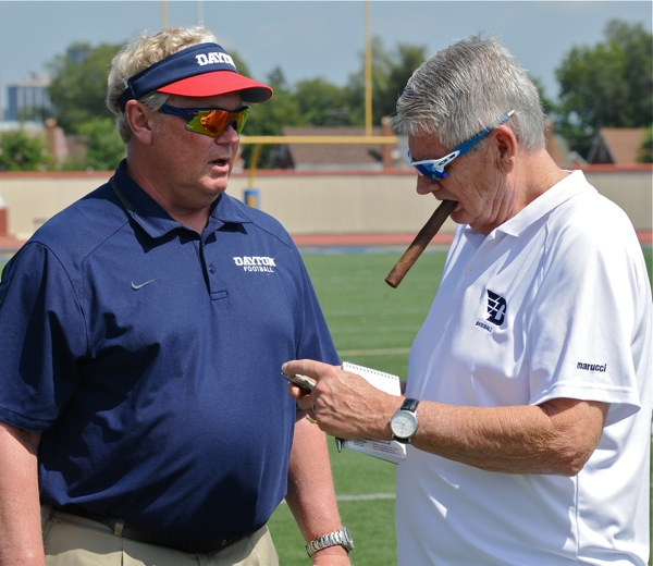 Chamberlin chews the fat over football - while Hal McCoy chews on a Monte Cristo during media day.