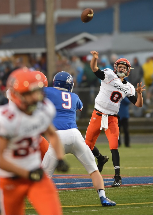 Quarterback Sam Broering unloads the second of his second half touchdowns to Ben Wenning (foreground). It closed the margin, for a time, to 17-14.