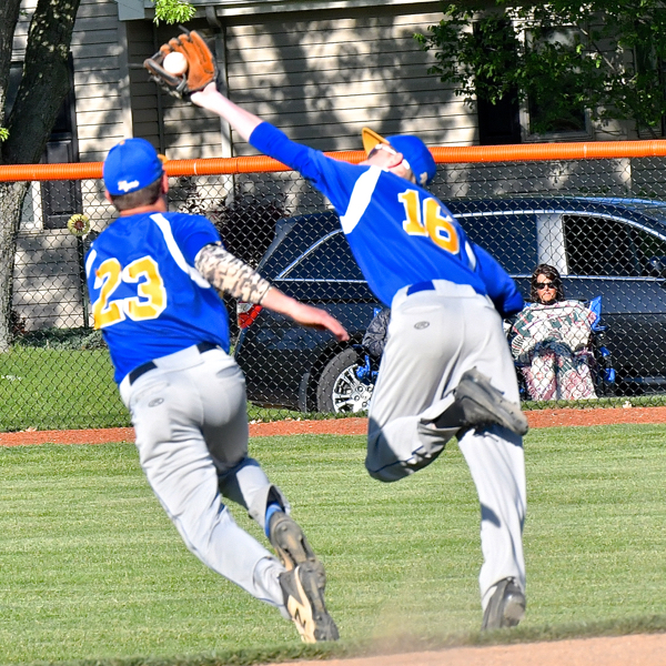 Marion's Matt Rethman (above, right) tries to get his glove on a ball that fell for a base hit in the fifth inning.