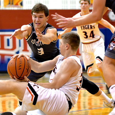 Covington's Jett Murphy goes after a loose ball