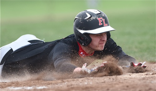 Loramie's Carter Siegel stretch for the plate during the Redskins' fourth inning outburst.