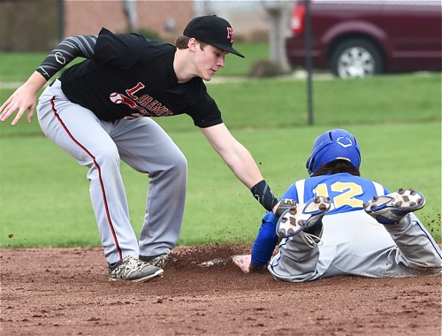 Loramie shortstop Devin Wehrman tags out a Marion runner on a steal attempt in the fifth inning.