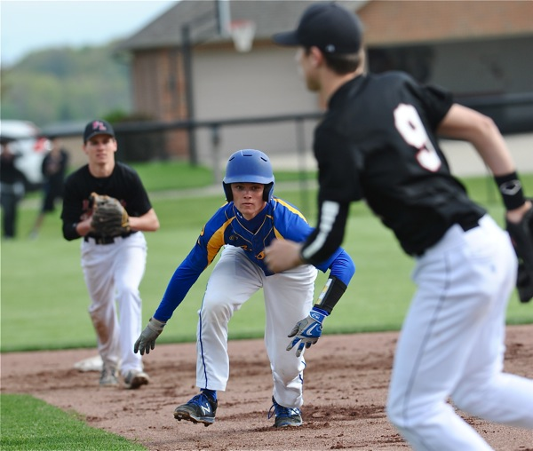 No man's land...Russia's Clay George found himself trapped between a pair of Loramie infielders.