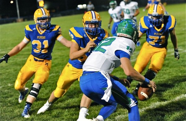 CJ quarterback Ryan Peltier looks up to see a Flyer greeting party on this pass attempt in the fourth quarter.