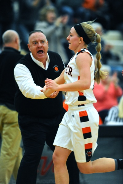Wiss congratulates Lindsay Roetgerman on her last-second shot before the half.
